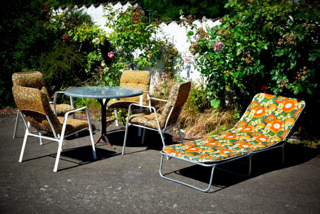 Retro garden furniture from the 70 ties in garden. Denmark