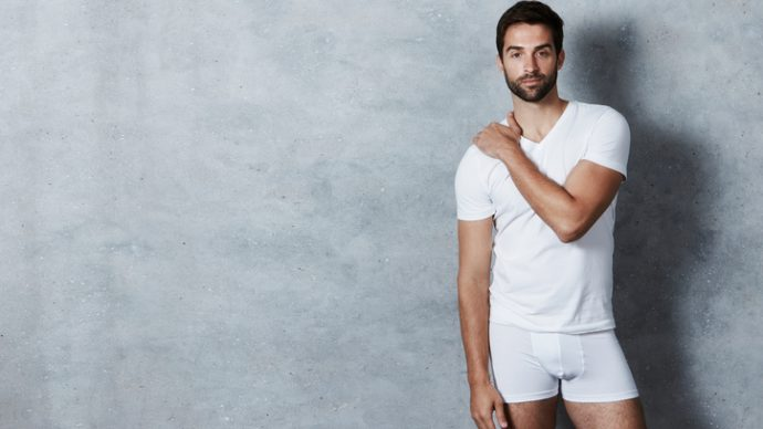 T-shirt and shorts guy in grey studio